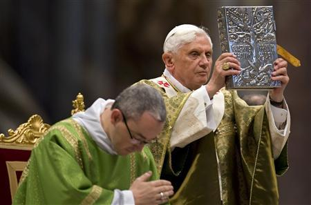 Pope Benedict XVI holds the book of the gospels as he leads a mass to celebrate the end of the Synod of the Bishops in Saint Peter Basilica at the Vatican October 26, 2008. REUTERS/Max Rossi