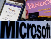 <p>A Google T-Mobile G1 mobile telephone is seen in New York City, October 22, 2008, (L), pedestrians walk past the Time Square Yahoo sign in New York April 7, 2008 (R) and a Microsoft Corp sign is seen at a news conference in Tokyo May 7, 2008. REUTERS/Mike Segar/ Joshua Lott/ Yuriko Nakao</p>