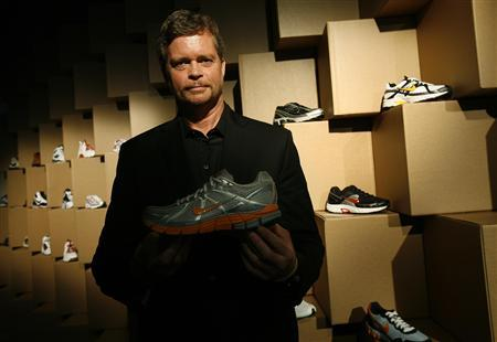 Nike Chief Executive Mark Parker poses with the Nike Pegasus 25 running shoe after the Nike Considered Design news conference in New York October 28, 2008. REUTERS/Shannon Stapleton