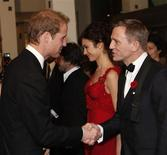 "<p>Britain's Prince William (L) shakes hands with British actor Daniel Craig at the world premiere of the latest James Bond movie ""Quantum of Solace"" at Leicester Square in London October 29, 2008. REUTERS/Stephen Hird</p>"
