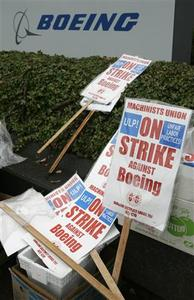 Strike signs lay idle outside the Boeing plant in Seattle, Washington, November 1, 2008. REUTERS/Robert Sorbo