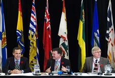 <p>Jim Flaherty, Canadian Minister of Finance, sits with Mark Carny (L), the Governor of the Bank of Canada, and Rob Wright, Deputy Minister of the Department of Finance (R) before the federal and provincial finance ministers meeting in Toronto November 3, 2008. REUTERS/Mark Blinch</p>
