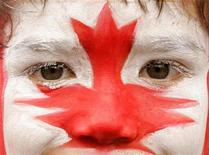 <p>A young rugby supporter has his face painted in the Canada national colors during the Hong Kong Sevens rugby tournament in Hong Kong March 30, 2008. REUTERS/Victor Fraile</p>