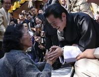 <p>Bhutan's Crown Prince Jigme Khesar Namgyel Wangchuck (R) is greeted by a well wisher during his visit to temple Wat Phra That Doi Suthep in Chiang Mai November 24, 2006. REUTERS/Stringer</p>