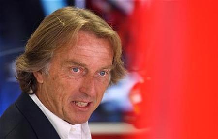 Ferrari's President Luca Cordero di Montezemolo smiles as he arrives for the third practice session at Monza racetrack in Monza, Italy, September 8, 2007. REUTERS/Max Rossi