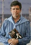 "<p>U.S. writer Jay McInerney poses with his book ""La belle vie"", or ""The Good Life"", after he was awarded with the literary award at the 33rd American Film Festival in Deauville September 6, 2007. REUTERS/Vincent Kessler</p>"
