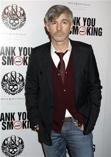 Australian director Baz Luhrmann arrives as a guest for the Los Angeles premiere of the film ''Thank You for Smoking'' in Los Angeles, California March 16, 2006. REUTERS/Fred Prouser