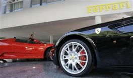 <p>People check out Ferrari sport cars inside a Ferrari dealer's showroom in Sao Paulo July 22, 2008. REUTERS/Paulo Whitaker</p>