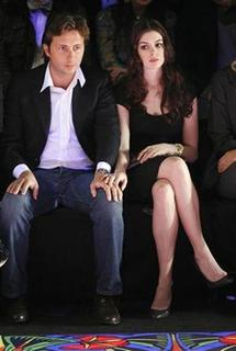 Actress Anne Hathaway sits with then-boyfriend Raffaello Follieri (L) in the front row during the 2008/2009 Miss Sixty fall collection show during New York Fashion Week in this February 3, 2008 file photo. REUTERS/Lucas Jackson/Files