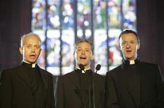 <p>Father Eugene O'Hagan, Father Martin O'Hagan and Father David Delargy (L-R) are seen singing as they pose for the photographer in St Patrick's Cathedral in Armagh, Northern Ireland in this September 9, 2008 file photo. REUTERS/Michael Cooper</p>