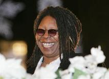 <p>Whoopi Goldberg smiles during the lighting of the Christmas tree at Rockefeller Center in New York City on November 30, 2005. REUTERS/Seth Wenig</p>