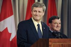 <p>Canada's Prime Minister Stephen Harper (C) holds a news conference with Finance Minister Jim Flaherty (R) at the Canadian Embassy after the G20 Summit on Financial Markets and the World Economy in Washington, November 15, 2008. REUTERS/Jonathan Ernst</p>