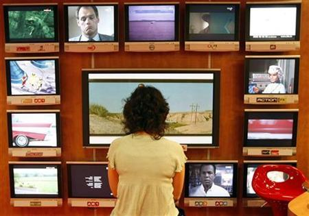 A visitor looks at television programs in Cannes, southeastern France, October 13, 2008. REUTERS/Eric Gaillard