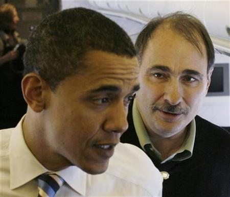 David Axelrod listens as Barack Obama speaks to the media on their campaign aircraft from Boise, Idaho, to Minneapolis, Minnesota, February 2, 2008. REUTERS/Jason Reed
