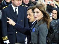 <p>France's President Nicolas Sarkozy (C) arrives with his wife Carla Bruni-Sarkozy (R) at the Douaumont memorial near Verdun, eastern France, November 11, 2008 during ceremonies commemorating the end of WWI. REUTERS/Gerard Cerles/Pool</p>