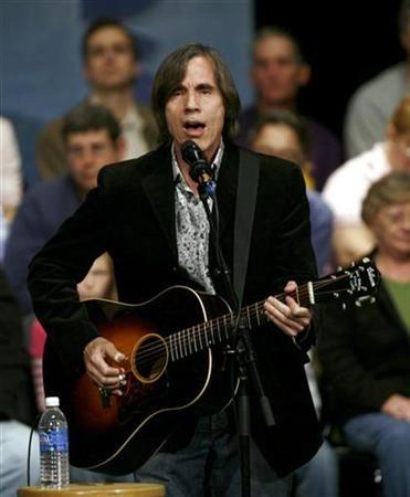 Musician Jackson Browne performs before a town meeting for former Democratic presidential candidate and former U.S. Senator John Edwards in Iowa City, Iowa, in this November 19, 2007 file photo. Browne has sued John McCain for copyright infringement, accusing the presumptive Republican nominee of using the singer's 1977 hit ''Running on Empty'' in a campaign ad without permission. REUTERS/Shannon Stapleton/Files
