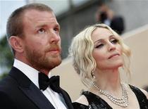 <p>Singer Madonna and director husband Guy Ritchie arrive on the red carpet at the 61st Cannes Film Festival in this May 21, 2008 file photo. REUTERS/Eric Gaillard/Files</p>