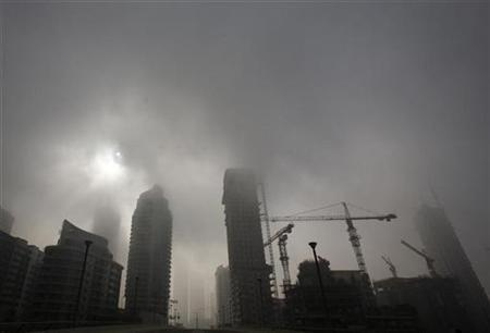 Early morning fog is seen in the marina area of dubai october 16 2008