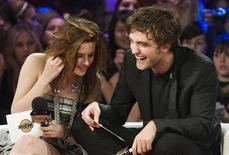 <p>Actors Robert Pattinson and Kristen Stewart (L) of the movie Twilight speak at the MuchMusic television station in Toronto, November 15, 2008. REUTERS/Mark Blinch</p>