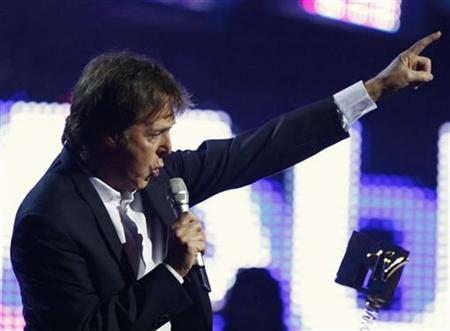 British singer Paul McCartney takes to the stage to collect the Ultimate Legend award during the MTV Europe Music Awards ceremony in Liverpool, northern England, November 6, 2008. REUTERS/Phil Noble