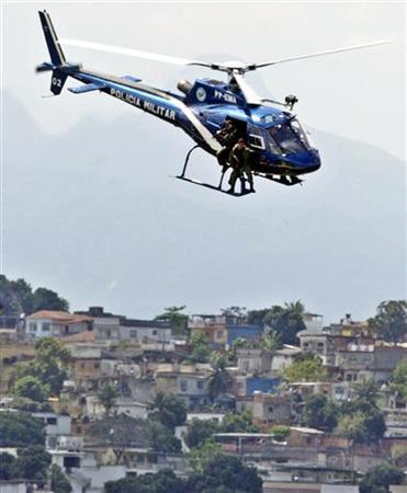 A Brazilian police helicopter swoops over a slum of Rio de Janeiro in a file photo. REUTERS/Bruno Domingos