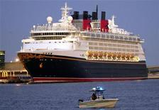 <p>The Disney Cruise Line's ship Magic sits moored at Port Canaveral in Cape Canaveral, Florida on November 30, 2002. REUTERS/Rick Fowler</p>