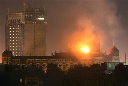 Smoke and fire billows out of the Taj Hotel in Mumbai, November 27, 2008. REUTERS/Peter Keep