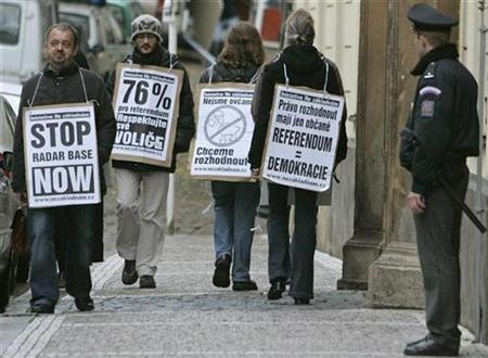 Demonstrators are seen with placards as they walk past the Czech Parliament in Prague October 29, 2008. The placards read (2nd L to R) ''respect your voters'', ''we want to decide'' and ''referendum = democracy''. REUTERS/David W Cerny