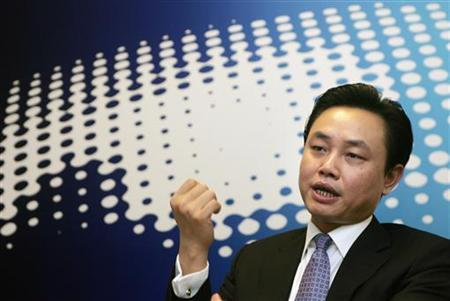 Huang Guangyu, chairman of GOME Electrical Appliances Holding Ltd., gestures during an interview at Reuters China Century Summit in Beijing September 7, 2006. REUTERS/Jason Lee
