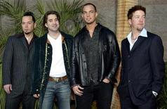 <p>Members of the rock band Creed, from left, bassist Brett Hestla, singer Scott Stapp, guitarist Mark Tremonti and drummer Scott Phillips, arrive at the 2002 Billboard Music Awards show at the MGM Grand Garden Arena in Las Vegas, Nevada, December 9, 2002. Creed won four awards including Group/Duo of the Year. REUTERS/ Steve Marcus</p>