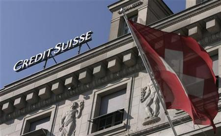 A picture shows the logo of the Credit Suisse bank next to a Swiss flag in Lucerne February 19, 2008. REUTERS/Michael Buholzer