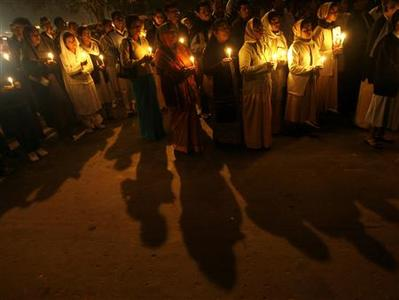 People hold candles during a vigil held for the victims of Mumbai's recent attacks, in New Delhi, December 2, 2008. REUTERS/Adnan Abidi