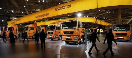Visitors walk along  display of MAN trucks during a preview day at the IAA commercial vehicles trade fair in Hanover in this September 24, 2008 file photo. REUTERS/Christian Charisius