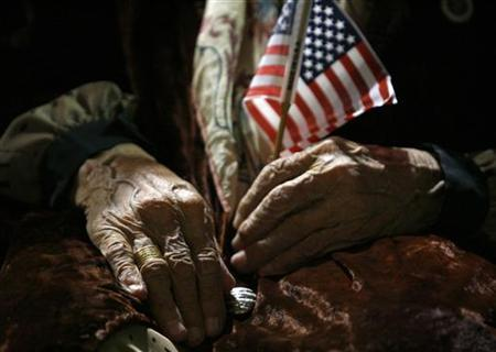 An elderly woman waits to be sworn in as a U.S. citizen during a naturalization ceremony in Pomona, near Los Angeles, California October 25, 2006. REUTERS/Lucy Nicholson
