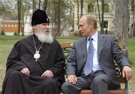Vladimir Putin, then president of Russia (R), speaks with Orthodox Patriarch Alexiy II during a meeting at Patriarch's residence in Peredelkino outside Moscow in this May 10, 2003 file picture. Patriarch Alexiy II, the head of Russia's powerful Orthodox Church, has died, the TASS news agency reported on December 5, 2008. REUTERS/ITAR-TASS/KREMLIN PRESS/Files