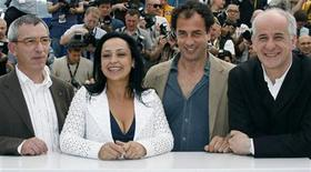 "<p>Italian director Matteo Garrone (2nd R) poses with cast members from (L-R) Gianfelice Imparato, Maria Nazionale and Toni Servillo during a photocall for the film ""Gomorra"" at the 61st Cannes Film Festival May 18, 2008. REUTERS/Eric Gaillard</p>"