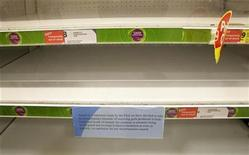 <p>A notice explaining the removal of pork produced from the North and South of Ireland is seen in front of empty shelves in a supermarket in Enniskillen, Northern Ireland December 8, 2008. REUTERS/Andrew Paton</p>