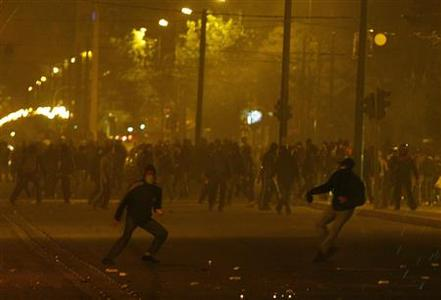 Protesters throw stones at policemen during riots in Athens, December 8, 2008. REUTERS/Yiorgos Karahalis