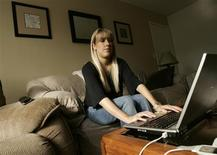 <p>Christine Chase, 24, searches for a job on her computer in her apartment in Campbell, California December 8, 2008. Chase was laid off from her contractor job at AT&T in the Silicon Valley in August, and is struggling to pay her bills with the money she receives from unemployment. With the holidays approaching and four fruitless months on the job search, she recently registered with a recruiting agency for help finding a job. Silicon Valley companies that initially resisted the swooning of the economy are looking to cut costs and shed entry-level positions, and people in their 20s are finding a college degree is no longer their golden ticket to a dream job in high tech. REUTERS/Robert Galbraith</p>