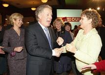 <p>Quebec Premier and Liberal leader Jean Charest (C) and his wife Michele Dionne (L) greet supporters at his election night rally in Sherbrooke, Quebec, December 8, 2008. REUTERS/Shaun Best</p>