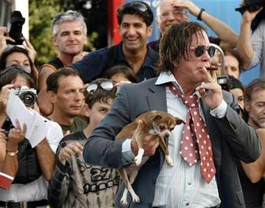 Mickey Rourke arrives with his dog Loki for the award ceremony of the Venice Film Festival, September 6, 2008. REUTERS/Denis Balibouse