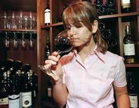 <p>A wine expert tastes a cup of an Argentine wine in Montreal, Canada in a file photo. REUTERS/Enrique Marcarian</p>