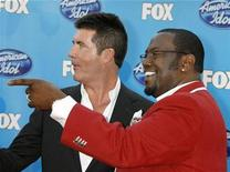 <p>Simon Cowell (L) and Randy Jackson, two of the judges on the American Idol television show arrive for the shows season finale in Los Angeles, California in this file photo from May 21, 2008. REUTERS/Fred Prouser</p>