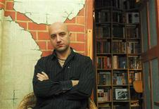 <p>Russian writer Zakhar Prilepin poses for a picture in his flat in Nizhny Novgorod in the Volga region, in this December 6, 2008 photo. A prominent banker and a popular leftist writer locked horns in a public debate over a social divide in crisis-hit Russia, revealing a growing social antagonism in a seemingly controlled Russian society.REUTERS/Mikhail Beznosov</p>