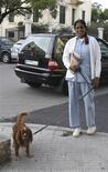 <p>A foreign domestic worker walks her employer's dog in a street in Beirut in this November 27, 2008 photo. REUTERS/Sara Fayad</p>
