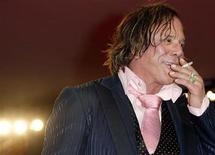<p>Mickey Rourke smokes a cigarette during a red carpet event at the Venice Film Festival September 5, 2008. REUTERS/Denis Balibouse</p>