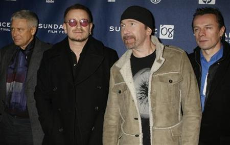 Members of the band U2 (L-R) Adam Clayton, Bono, The Edge and Larry Mullen pose for photographers as they arrive for the premiere of ''U2 3D'' the first digital 3D concert film by directors Catherine Owens and Mark Pellington at the 2008 Sundance Film Festival in Park City, Utah January 19, 2008. REUTERS/Fred Prouser