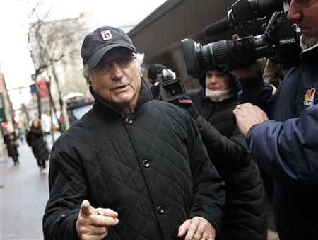 Bernard Madoff walks back to his apartment in New York December 17, 2008. Disgraced financier Madoff, accused of orchestrating a $50 billion fraud, was placed under house arrest on Wednesday as BNP Paribas became the latest European bank to be sideswiped by the scandal. REUTERS/Shannon Stapleton