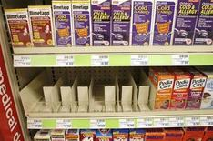 <p>Shelves that used to hold infants' nonprescription cough and cold products stand empty in a Washington drug store October 11, 2007. REUTERS/Kevin Lamarque</p>