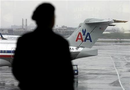 An American Airlines plane is seen parked at LaGuardia Airport in New York November 25, 2008. REUTERS/Shannon Stapleton